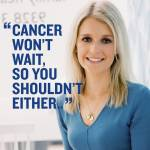 """A woman wearing a blue dress with the words """"cancer won't wait, so you shouldn't either"""""""